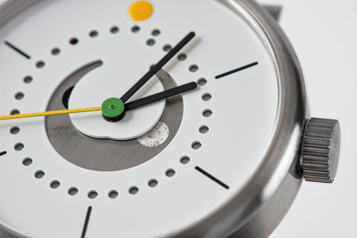 moon phase watch (42mm grade 5 titanium case case with white dial and yellow strap by ochs und junior, close up)