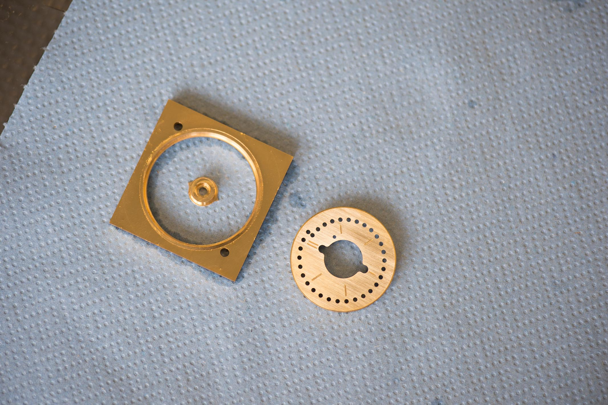 The finished dial and the spare material which will be recycled.